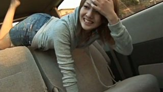 Redhead Japanese babe fooling in the car in the sunny afternoon