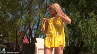 Wet and horny blondie Faye Barts stripteases in the pool