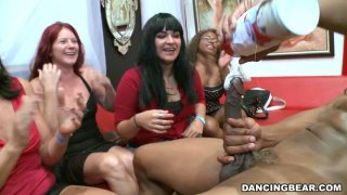 Girl are enjoying a dirty lap dance performed by solid built black stripper