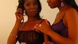 A steamy lesbian fuck with a dildo of two ebony babes in a dressing room