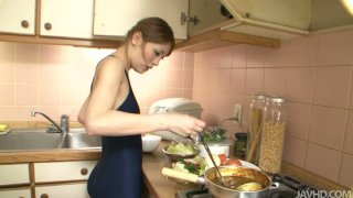 Cute Jap teen Yuu Mahiru cooks meal in her bathing suit