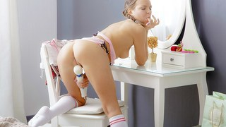 Erotic art video shows Candy Julia playing with a toy