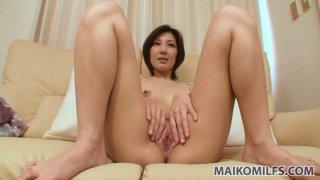 Shiny Japanese chick Mayumi Iihara takes pleasure by masturbating fluffy pussy